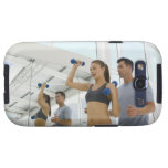 Woman lifting weights with trainer samsung galaxy SIII cover