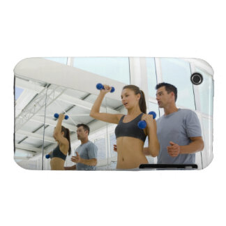 Woman lifting weights with trainer iPhone 3 cases