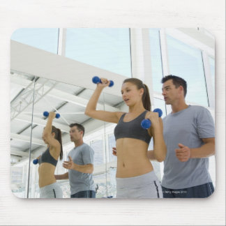 Woman lifting weights with trainer mouse pad