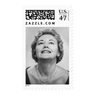 Woman Looking Up Stamp