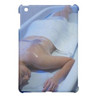 Woman lying down in vichy shower iPad mini case