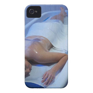 Woman lying down in vichy shower iPhone 4 case