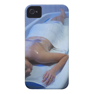 Woman lying down in vichy shower iPhone 4 cover