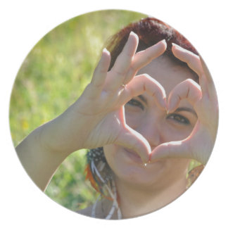 Woman making heart shape with her hands melamine plate