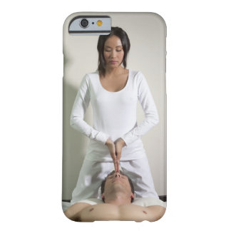 Woman messaging mans head barely there iPhone 6 case