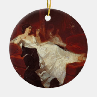 Woman on a red sofa ceramic ornament