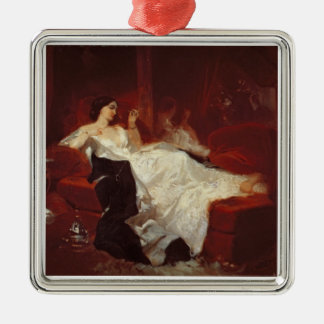 Woman on a red sofa metal ornament
