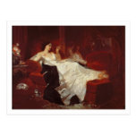 Woman on a red sofa post card