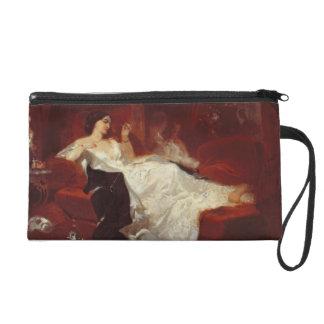 Woman on a red sofa wristlet purse