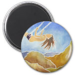 Woman on a swing over hills refrigerator magnet
