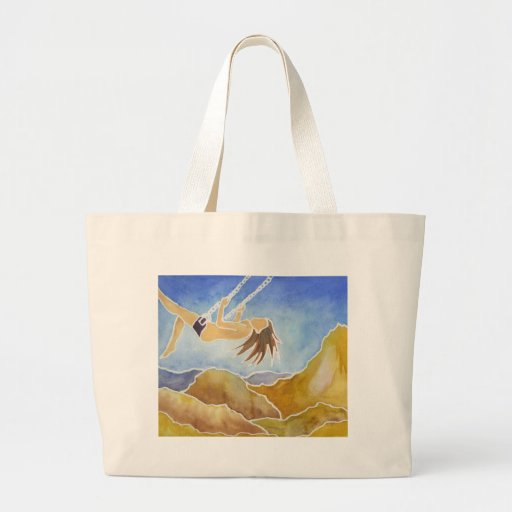 Woman on a swing over hills tote bag
