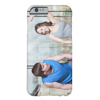 Woman on exercise bike triumphing over man barely there iPhone 6 case