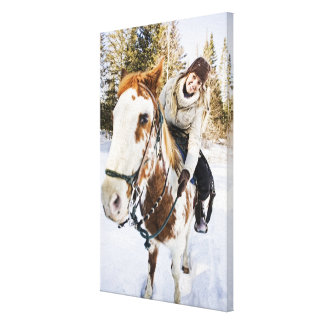 Woman on horse outdoors during winter canvas print
