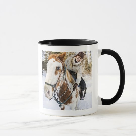 Woman on horse outdoors during winter mug