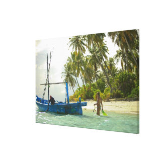 Woman on small traditional fishing boat, canvas prints