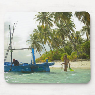 Woman on small traditional fishing boat, mousepad