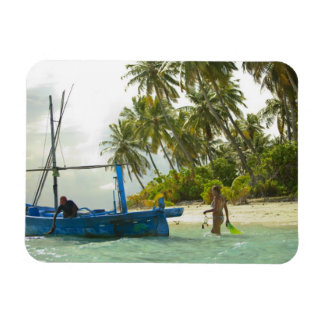 Woman on small traditional fishing boat, rectangular photo magnet
