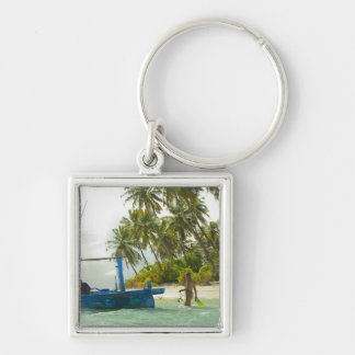 Woman on small traditional fishing boat, Silver-Colored square keychain