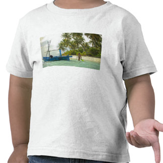 Woman on small traditional fishing boat, t-shirt
