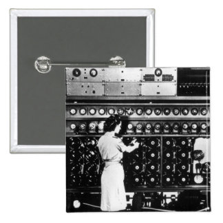 Woman Operates a Decryption Machine Button