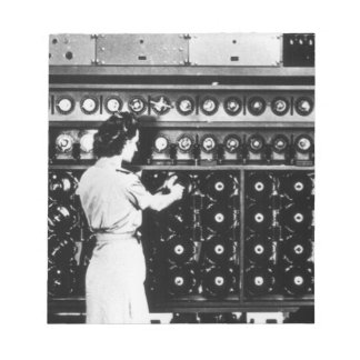 Woman Operates a Decryption Machine Notepad