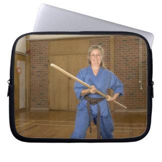 Woman performing Ken-Do-Kai Karate, smiling, Computer Sleeve