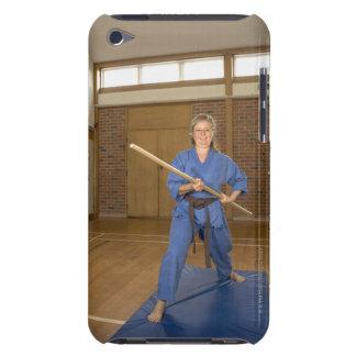 Woman performing Ken-Do-Kai Karate, smiling, iPod Case-Mate Cases
