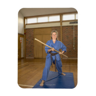 Woman performing Ken-Do-Kai Karate, smiling, Magnet