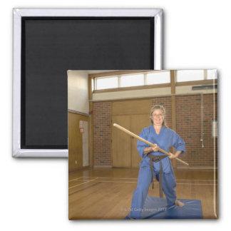 Woman performing Ken-Do-Kai Karate, smiling, Fridge Magnet