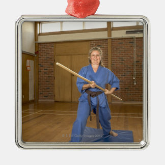 Woman performing Ken-Do-Kai Karate, smiling, Metal Ornament