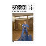 Woman performing Ken-Do-Kai Karate, smiling, Postage