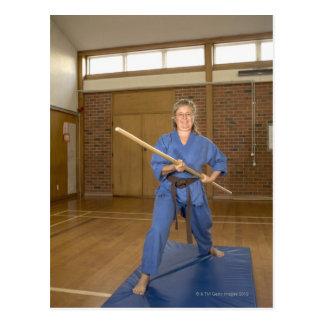Woman performing Ken-Do-Kai Karate, smiling, Postcard