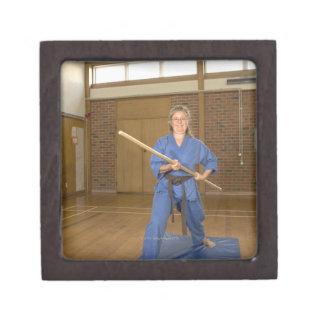 Woman performing Ken-Do-Kai Karate, smiling, Premium Trinket Box