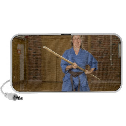Woman performing Ken-Do-Kai Karate, smiling, iPhone Speakers
