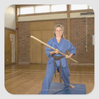 Woman performing Ken-Do-Kai Karate, smiling, Square Sticker
