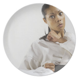 Woman performing martial arts 2 dinner plate