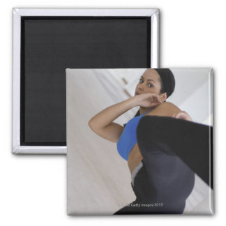 Woman performing martial arts 2 inch square magnet