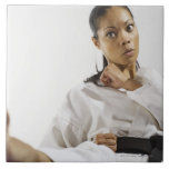Woman performing martial arts 2 large square tile