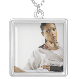 Woman performing martial arts 2 silver plated necklace