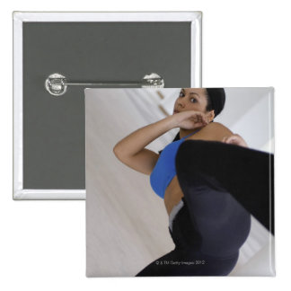 Woman performing martial arts buttons
