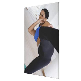 Woman performing martial arts canvas print