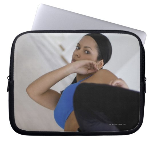 Woman performing martial arts laptop sleeve