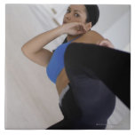 Woman performing martial arts large square tile