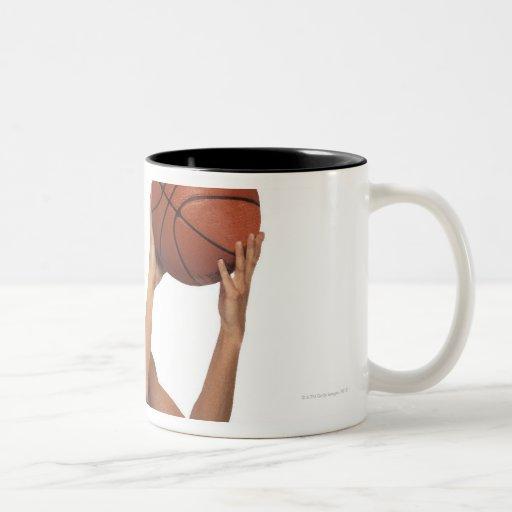 Woman player shooting basketball coffee mug