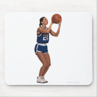 Woman player shooting basketball mouse pad