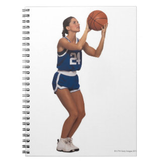Woman player shooting basketball spiral note book
