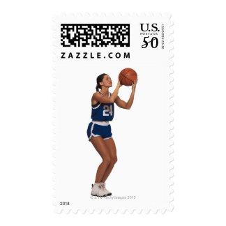 Woman player shooting basketball postage