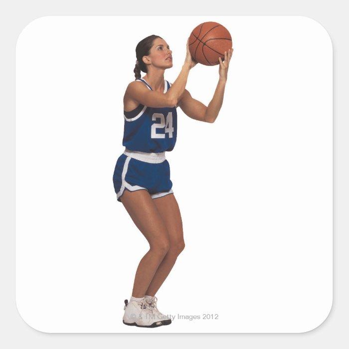 Woman player shooting basketball square sticker