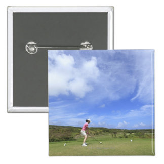 Woman playing golf 2 inch square button