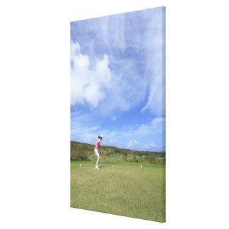 Woman playing golf stretched canvas print
